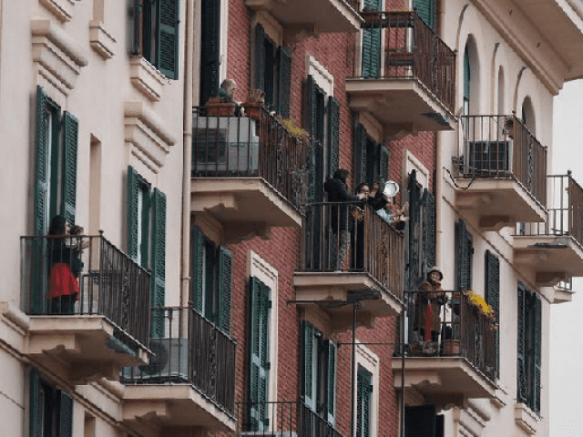 Italians Sing Out From Balconies to Lift Spirits